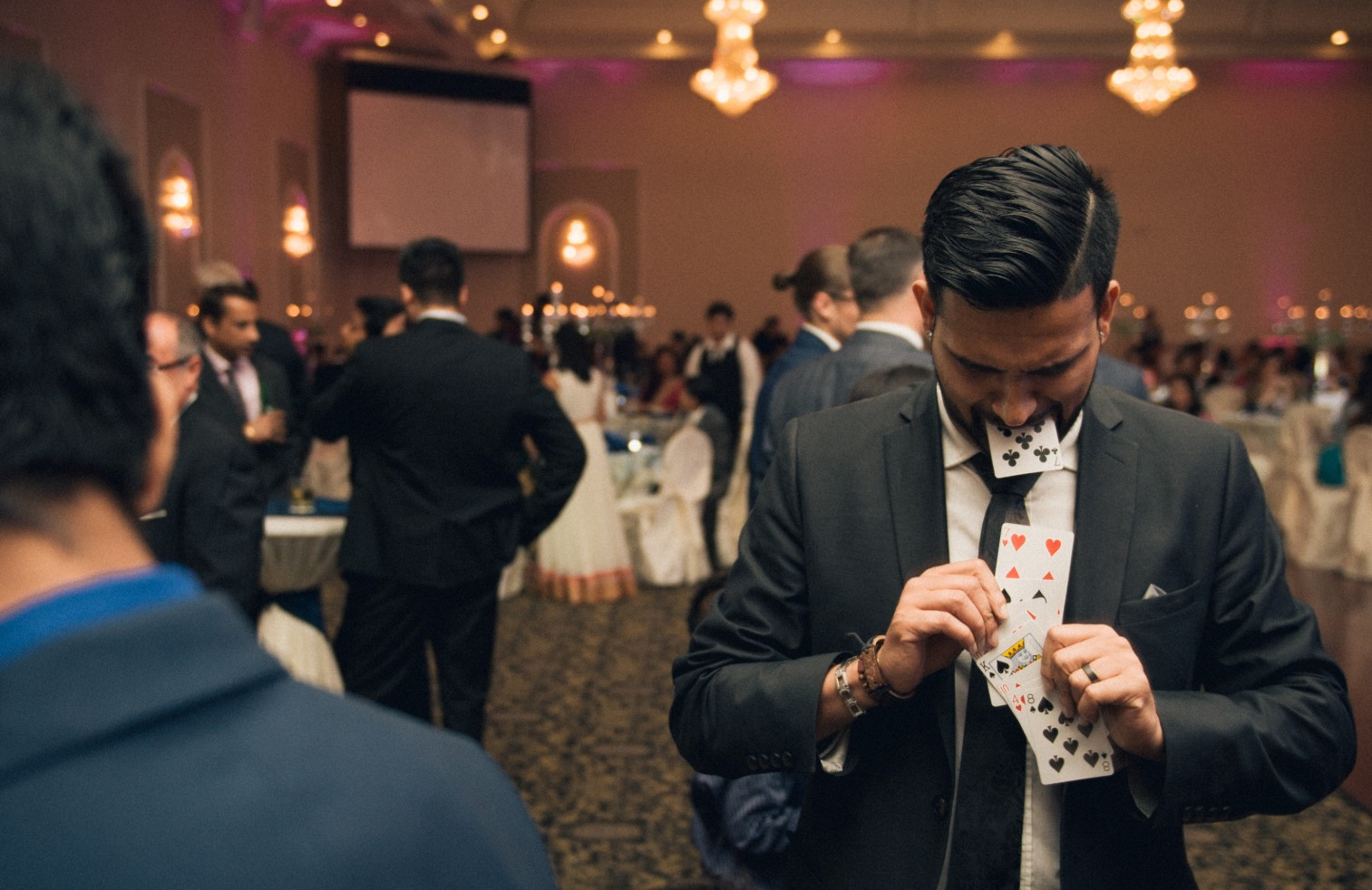 toronto wedding magician has cards coming out of his mouth