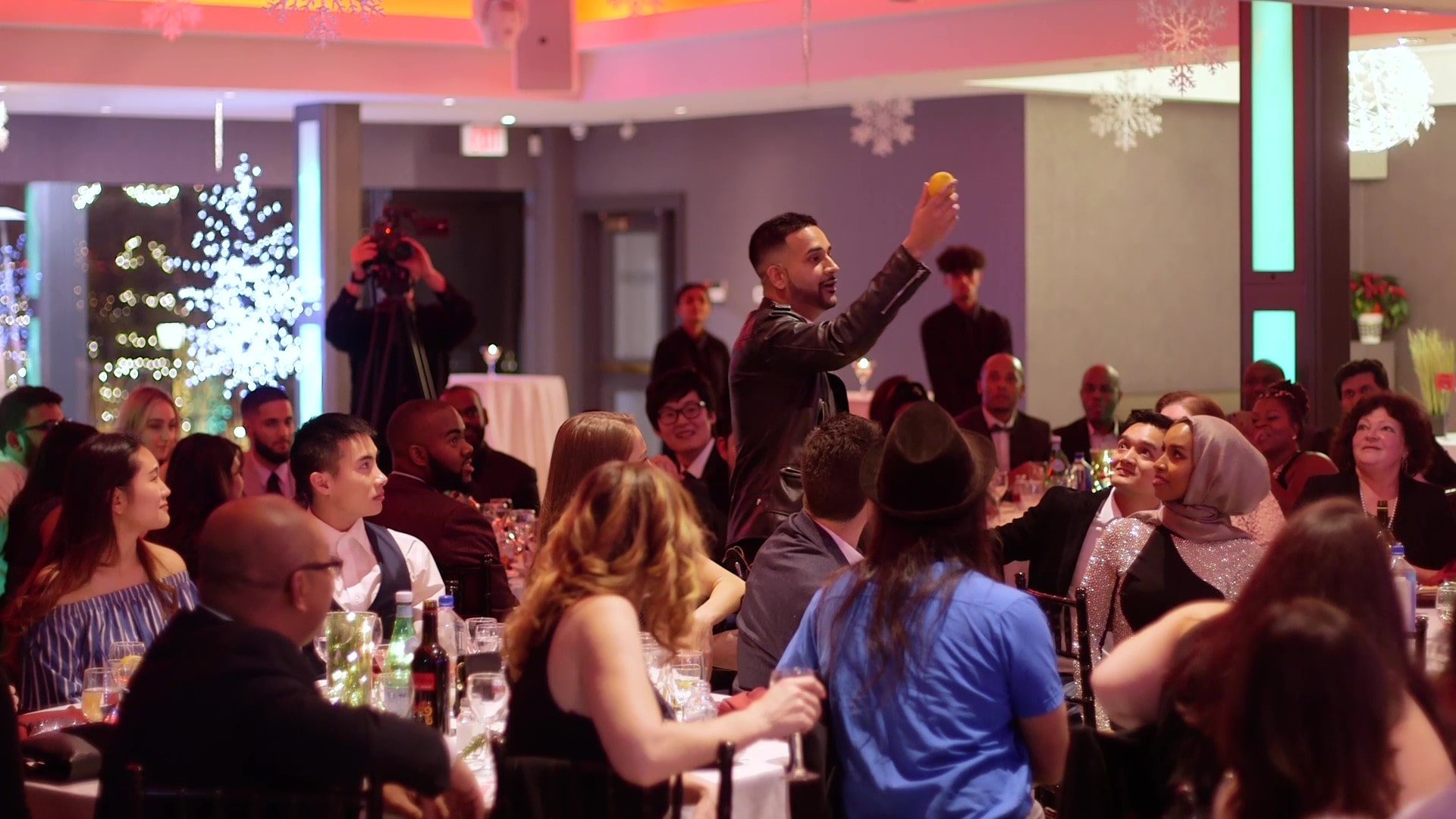 Toronto magician Durgy Spade performing at a banquet hall in Toronto